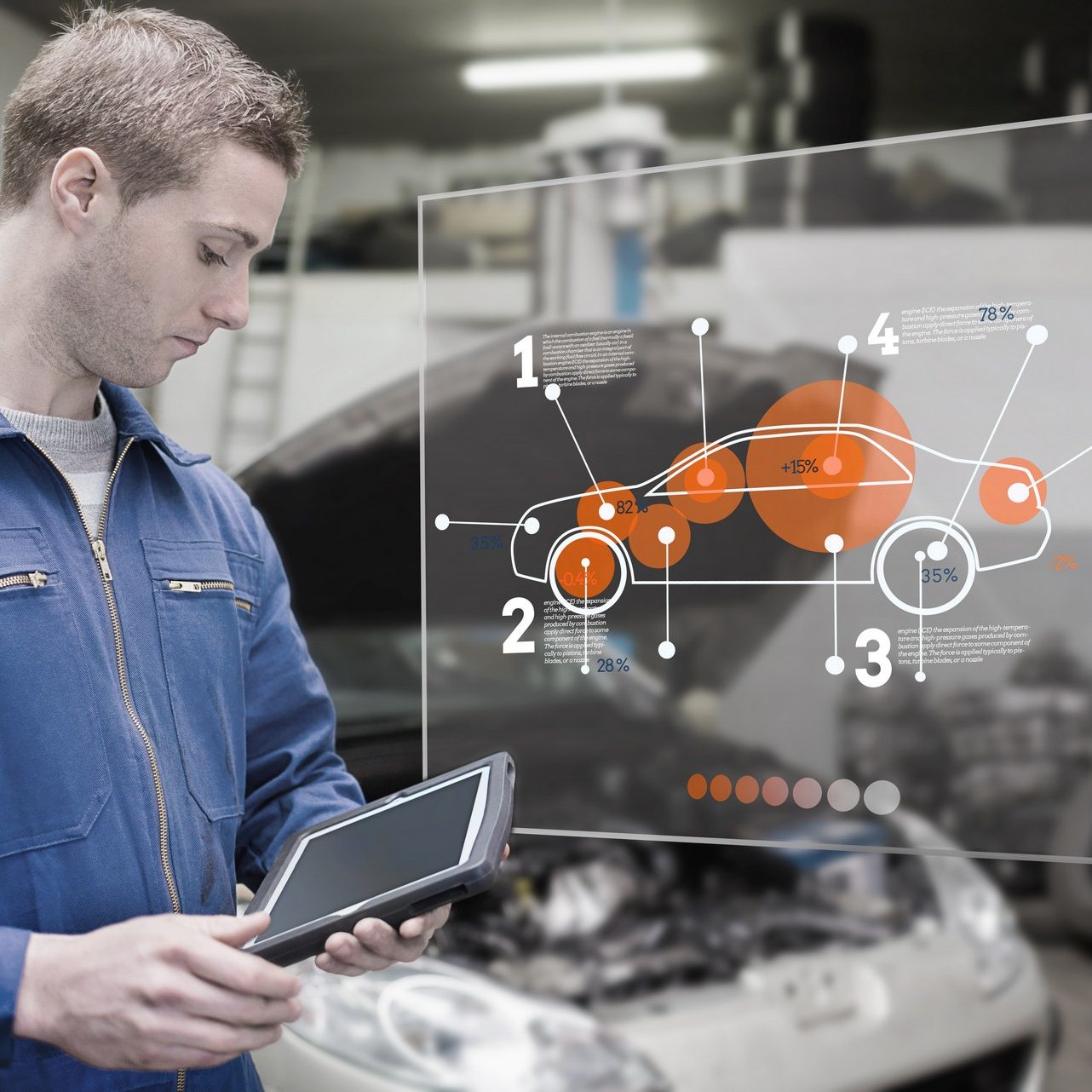 Mechanic using tablet and futuristic interface with diagram